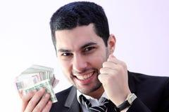 Hombre de negocios feliz con el dinero Fotos de archivo