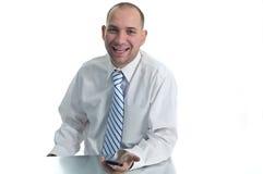 Hombre de negocios feliz con el teléfono Fotos de archivo libres de regalías