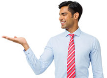 Hombre de negocios feliz Displaying Invisible Product imagenes de archivo