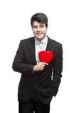 Hombre de negocios feliz joven el el día de tarjeta del día de San Valentín Fotografía de archivo libre de regalías