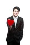 Hombre de negocios feliz joven el el día de tarjeta del día de San Valentín Imagen de archivo libre de regalías