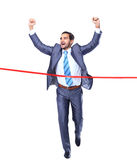 Hombre de negocios feliz que corre a través de línea de acabamiento Imagen de archivo
