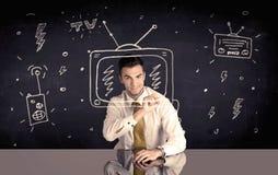 Hombre de negocios feliz que dibuja la TV y la radio Fotografía de archivo libre de regalías