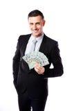 Hombre de negocios feliz que lleva a cabo dólares de EE. UU. Foto de archivo libre de regalías