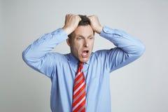Hombre de negocios frustrado Isolated Over White Fotografía de archivo