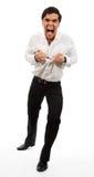 Hombre de negocios frustrado que rompe en dos su camisa Fotos de archivo libres de regalías
