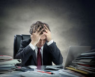 Hombre de negocios frustrado Sitting imágenes de archivo libres de regalías