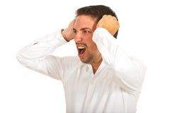 Hombre de negocios furioso que grita Imagenes de archivo