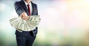 Hombre de negocios Give Dollars Cash foto de archivo libre de regalías
