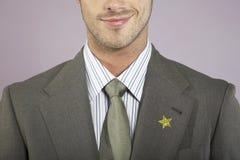 Hombre de negocios With Gold Star en el traje Imagen de archivo