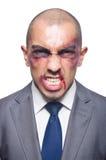 Hombre de negocios gravemente batido aislado Imagen de archivo