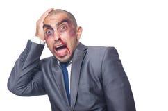 Hombre de negocios gravemente batido aislado Foto de archivo libre de regalías