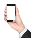 Hombre de negocios Hand que sostiene el teléfono elegante móvil con la pantalla en blanco Fotografía de archivo libre de regalías