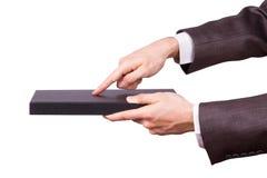 Hombre de negocios Hand Touching Book como tableta Foto de archivo