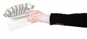Hombre de negocios Hand y dinero en sobre Foto de archivo