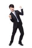 Hombre de negocios hermoso con los brazos aumentados en éxito Imagen de archivo