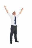 Hombre de negocios hermoso que anima con los brazos para arriba Imagenes de archivo