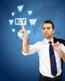 Hombre de negocios hermoso que señala al icono de la compra Imagen de archivo libre de regalías