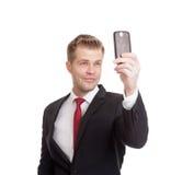 Hombre de negocios hermoso que toma un selfie Imagen de archivo libre de regalías