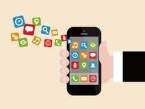Hombre de negocios Holding Smartphone con Apps Imágenes de archivo libres de regalías
