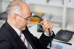 Hombre de negocios Holding Telephone Receiver Fotografía de archivo