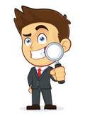 Hombre de negocios Holding una lupa Imagenes de archivo