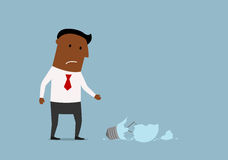 Hombre de negocios infeliz con idearfg5mnvbxxzdfsaaa quebrado Imagen de archivo