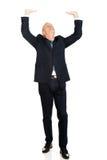 Hombre de negocios integral que empuja el techo invisible Fotos de archivo libres de regalías