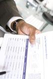 Hombre de negocios With Investment Papers fotografía de archivo libre de regalías