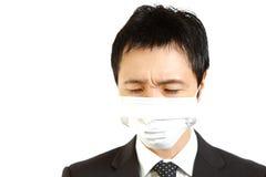 Hombre de negocios japonés con la máscara Imágenes de archivo libres de regalías