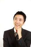 Hombre de negocios japonés que sueña en su futuro Fotos de archivo
