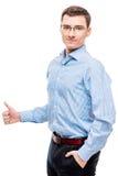 Hombre de negocios joven acertado masculino que presenta en blanco Imágenes de archivo libres de regalías