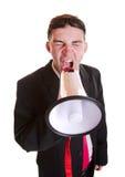 Hombre de negocios joven con el altavoz Imagen de archivo libre de regalías