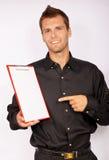 Hombre de negocios joven con el papel en blanco Imagenes de archivo