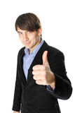 Hombre de negocios joven con el pulgar para arriba aislado en el fondo blanco Imágenes de archivo libres de regalías