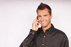 Hombre de negocios joven con el teléfono Fotografía de archivo libre de regalías
