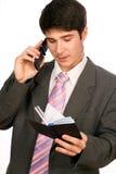 Hombre de negocios joven con el teléfono Imágenes de archivo libres de regalías