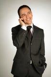 Hombre de negocios joven con el teléfono celular Imagenes de archivo