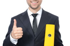 Hombre de negocios joven con la carpeta del fichero Imágenes de archivo libres de regalías