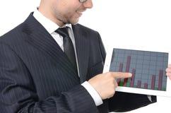 Hombre de negocios joven con la tableta Foto de archivo libre de regalías