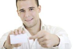 Hombre de negocios joven con la tarjeta vacía aislada Foto de archivo libre de regalías