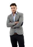 Hombre de negocios joven con los brazos plegables Fotografía de archivo libre de regalías