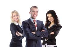 Hombre de negocios joven con sus colegas Imagen de archivo libre de regalías