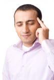 Hombre de negocios joven con un dolor de cabeza Imagen de archivo