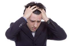 Hombre de negocios joven con un dolor de cabeza Fotografía de archivo