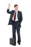 Hombre de negocios joven con un gesto que da la bienvenida Foto de archivo