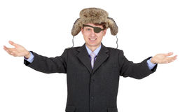 Hombre de negocios joven con una ojo-corrección en sombrero de piel Fotos de archivo libres de regalías
