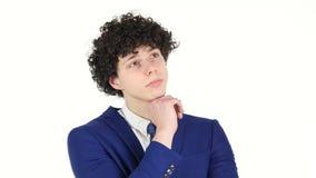Hombre de negocios joven de pensamiento, fondo blanco almacen de metraje de vídeo
