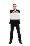 Hombre de negocios joven elegante con la maleta del metal Aislado en el fondo blanco Imagen de archivo