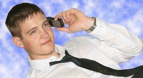 Hombre de negocios joven en el teléfono foto de archivo libre de regalías